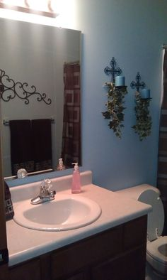 Pic Of blue brown bathroom like candle holders minus the leaves
