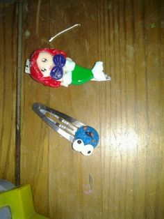 Arial hair clip and cookie monster hair clip out of polymer clay