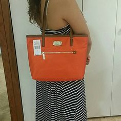 Michael Kors clementine Tote Made of uniquely designed fabric and trimmed with fine natural leather. Fabric has been treated to be water and stain resistant. Material is Montauk nylon and trimmed in leather. Michael Kors Bags Totes