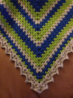 Simple shawl using Bobwilson123's pattern found on YouTube. Used Cascade's Heritage yarn in Seattle Seahawk colors. Ready for opening kickoff, Sept. 4th.