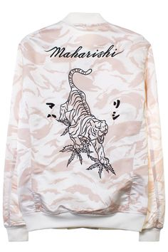 MAHARISHI CAMO TOUR JACKET Tan and off-white colored camo jacket; patch on front, embroidery on back, and black buttons. Made in India. 40% Silk 60% Polyester. SIZE & FIT Fits true to size. MAHARISHI Founded by Hardy Blechman, Maharishi aims to create environmentally sound, fair-trade produced, high-quality, utilitarian clothing.
