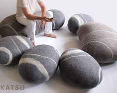"""Poufs made of wool. Models of poufs """"Sea Pebble"""" and """"Scandinavian Stone"""". A set of or or 7 stones. KATSU is wool cushions and poufs. Pouf Ottoman, Floor Cushions, Floor Pouf, Wool Pillows, Throw Pillows, Kid Spaces, Wool Felt, Felted Wool, Lana"""