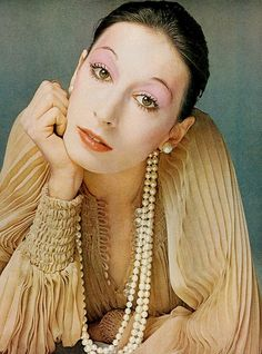 Anjelica Huston in a pale chiffon dress by Scott Barrie, photographed by Richard Avedon for a Vogue US beauty editorial, November 1972.