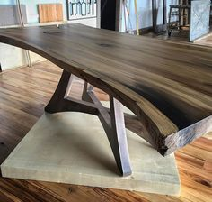 Beautiful reclaimed woodworking by Barns and Mills - perfect for interiors of log homes. Nicely appointed log cabins using reclaimed furniture. This #Liveedge #RainbowPoplar #Slab #DiningTable with #Antique #Oak