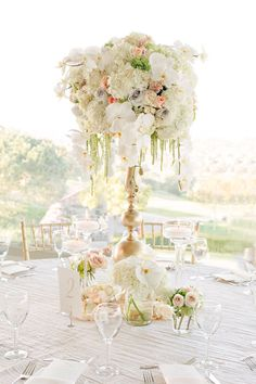 16 Tall and Dramatic Wedding Centerpieces | Find more inspiration here: http://www.preownedweddingdresses.com/blog/16-tall-and-dramatic-wedding-centerpiece-designs