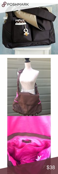 Pottery Barn Kids ultimate diaper bag Pottery Barn Kids the Ultimate Diaper Bag. Brown with bright pink lining. Can be carried over the shoulder or as a backpack. No longer available at PBK. Pockets on sides for bottles, etc. plenty of room for all the essentials. Excellent condition. pottery barn kids Accessories Bags