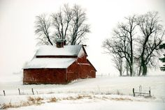 Winter Barn Scene by Kim Ladd - Red barn during winter storm Click on the image to enlarge.