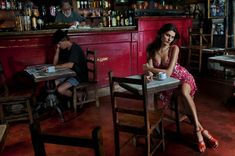 Isabeli Fontana by Steve McCurry for the Pirelli Calendar 2013.    Fashion? Portrait? Clearly staged, but in a very real place giving it a hint of documentary?