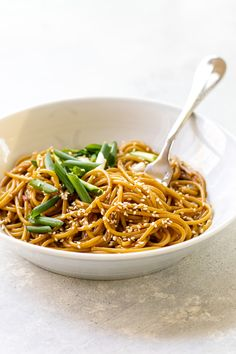 These easy sesame noodles for one take less than 15 minutes! #noodles #peanutbutter #oystersauce #soysauce #greenonions #takeoutrecipes #easy recipes #recipesforone