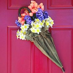 How cool!! Umbrella with flowers as door wreath  I feel pretty... Oh, so pretty...I feel pretty, and witty, and bright!