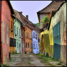 Sighisoara, Romania, the only inhabited medieval citadel in Europe - nice lighting Places Around The World, The Places Youll Go, Places To See, Around The Worlds, Beautiful World, Beautiful Places, Colourful Buildings, Colorful Houses, Old Street