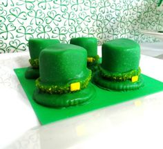 Marshmallow-Ritz cracker Leprechaun Hats dipped in green candy melts and sprinkles with a tiny yellow Chiclet for a buckle.  Super easy, super cute