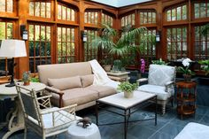 sunroom with wooden traditional window, brown sofa, rattan chairs with white cushion, white wooden chairs, white coffee table, white wooden side table, white table lamp, g of Beautiful Sunroom to Summon the Natural Surrounding