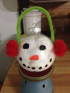 Frosty the snowman used cotton balls for the inside, red balls and pipe cleaner for the ear muffs and used paint for the face
