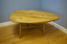 Made entirely from Oak, this coffee table is hand crafted using wedge joinery. Visible from the table top and on the legs, the wedges are left showing to highlight the craftsmanship involved in constructing this table. http://jgriffindesign.co.uk/