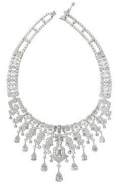 Diamond necklace by Cartier. Vogue.