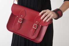 "Backstage dress, Swans, Cranbrook    11"" red satchel,  @The Cambridge Satchel Company    Red leather 'Cuff' bracelet, Milski,"