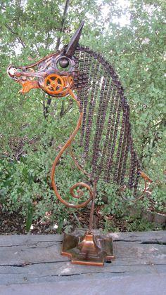 Horse Garden Art Sculpture . Horse garden art made from recycled metal objects . Stands 78 cm high x 50 cm in width .