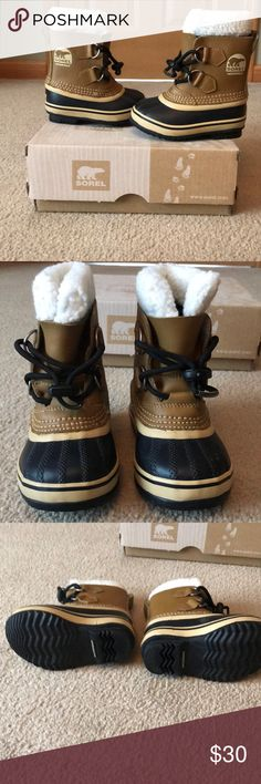 Toddler size: 7 Yoot PAC boot in mesquite Boy or girl toddler sorel boots Size: 7 toddler Mesquite leather with black rubber sole and toe, white shearling lining. Very sturdy, well made boot  Waterproof and rated for up to -40 degree weather New in box, never worn Toggle shoelace closure, adjustable Sorel Shoes Rain & Snow Boots