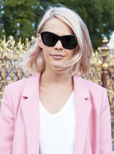 Pink hair, pink lipstick, pink coat, black shades: foolproof way to make the girlie shade all the more edgy.