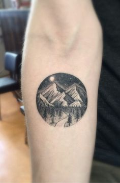 Circular mountain tattoo