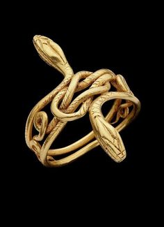 Composed of two… The Pelusian Gold Snake RingA Graeco-Roman gold snake ring. Composed of two… Gold Snake RingA Graeco-Roman gold snake ring. Composed of two… Snake Jewelry, Gold Jewelry, Jewelry Accessories, Jewelry Design, Fine Jewelry, Ancient Jewelry, Antique Jewelry, Vintage Jewelry, Egyptian Jewelry