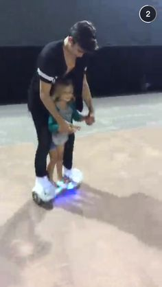 hayes teaching sky how to ride a glidr adorable