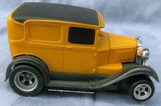 Full fendered 1930 Model A panel truck HO scale slot car was manufactured by Aurora in their A/FX series. The car looked neat, but the 4-gear chassis was slow compared to the 3-gear chassis A/FX series cars.