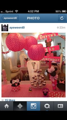 Minnie Mouse Smash Cake and cupcakes on a dessert table
