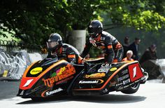 Dave Molyneux won his career Isle of Man TT race with a victory in the first Sure Sidecar TT race of the 2012 festival. The win comes in Molyneux's return to the Isle of Man TT after sitting out last year's competition. Motorcycle Racers, Racing Motorcycles, Honda Fireblade, Side Car, Riders On The Storm, Bike Poster, Japanese Motorcycle, Isle Of Man, Classic Bikes