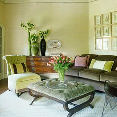 Use your favorite color in different shades for a room that screams you. Shades of green color this living room. A muted green on the walls sets a backdrop for a celadon chair and pillows, a sage ottoman, and shamrock vases. Browns and pinks accent the space and rich fabrics, like velvet, add texture and depth.