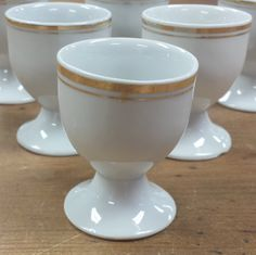 Set of 6 White Porcelain Egg Holders/Cups ~ Gold Rims and Inset Bands ~ Possibly PM Porzellanfabrik Moschendorf Bavaria by FeeneyFinds on Etsy