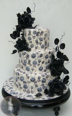 I finally got to do a black rose cake!  This is my third painted rose cake, and I used food colors and vodka to paint on the fondant (with a...