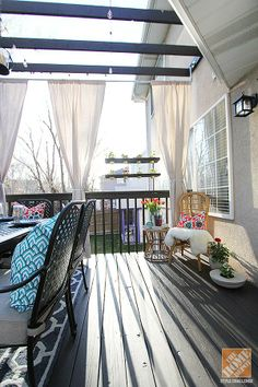Deck Decorating Ideas: Pergola, DIY curtain rods and drapes made from drop cloths. Take a look at this exceptional deck makeover by Jen Stagg of withHeart. || @Jennifer Stagg