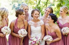Bride and bridesmaids sharing a fun moment together | Ashley Gerrity Photography | Whitemarsh Country Club, Lafayette Hill Wedding