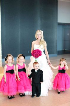 Bright pink flowers agains white dress