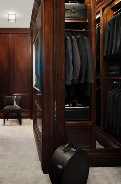 Sleek and unfussy traditional dark wood panelled dressing room.