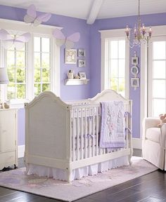 A cute nursery for a girl. I would also add sage green to make it a little less purple!