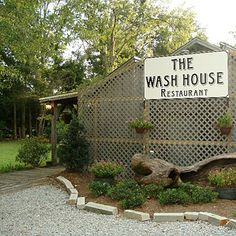 Fairhope, Alabama. Set back from the road in what looks like a wooden shack, The Wash House restaurant and bar is distinctively elegant inside, with dark paneled walls and white lights strung on large branches hanging from the ceiling.   Coastalliving.com