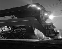 """""""Southern Pacific Daylight locomotive # 4449 at night in the Uceta railroad yard in Tampa, Florida, December 1976."""""""