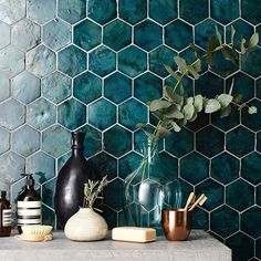 Handmade in Portugal... Our New Terracotta glazed tiles will always be a firm favourite #tiles #design #interiordesign #walltiles #colour #shape #pattern #hexagon #handmade #homedecor #bathroomdesign #kitchendesign #teal #styling #interiorstyling #glazedtiles