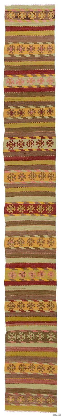 A long, vintage kilim runner rug around 50 years old and in very good condition. This rug was hand-woven in the Sivas region of Central Anatolia, Turkey.