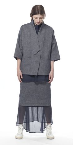 15323 Jogori Polygon Jacket Reminiscent of a traditional Korean work shirt juxtaposes with jacket, cut in a generous, yet restrained box silhouette.  Unlined, subtle cocoon shape in an Italian linen-infused cotton denim, tailored with impeccable inner binding in a pop of sprout yellow. Hidden metal snaps secure the jacket with an architectural shape. 65% Ctn, 35% Linen   Also available in the following color(s): Copper Shimmer COLOR: INK DENIM Work Shirts, Copper, Korean, Normcore, Silhouette, Ink, Shape, Traditional, Denim
