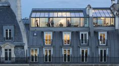 Transparent Intentions: 13 Glass Additions to Historic Architecture — WebUrbanist – Dachaufstockung Atelier Architecture, Architecture Renovation, Roof Architecture, Historical Architecture, Paris Rooftops, Mansard Roof, Roof Extension, Great Buildings And Structures, Modern Buildings