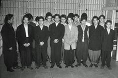 The men pictured here are wearing zoot-suits which were traditionally associated with urban jazz culture. These men were urban minorities and/or juvenile delinquents whose choice of dress communicated information about their background and ethnicity. Many young zoot-suit wearers brought their post-war political frustrations to the media's attention during the zoot-suit riots of 1943.
