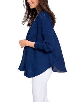 Esprit-neuletakki kaunista joustinneuletta, takakappale kangasta. Ei napitusta. 3/4-pituiset hihat. Poimutus ylhäällä takana. Pyöristetty helma. Pituus n. 73 cm koossa L. <br><br>50% puuvillaa, 50% viskoosia<br>Istuvuus: regular<br>Pesu 30°