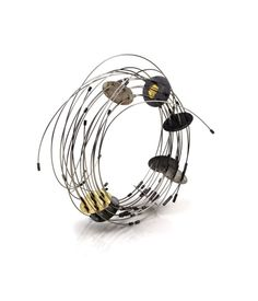 Maria Rosa Franzin bracelet Unique Piece Materials: Pure gold, gold, oxidized silver, steel 1665€ - 2016
