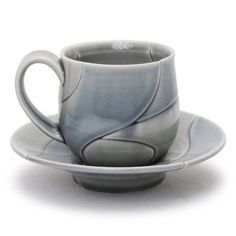 Shop: Grey Leaf Cup and Saucer - The Clay Studio