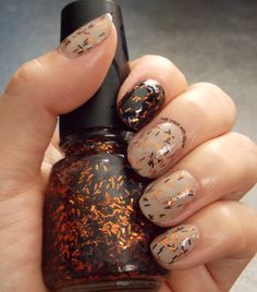 Essie: Brooch the subject Sally Hansen: Black Heart and Color Zone: Orange and Black glitter