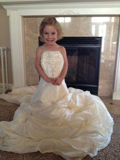 Emma in her mommy's wedding dress.